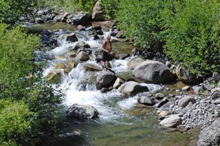 fisherman in creek